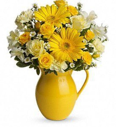 Roses, carnations, spray roses, gerberas, alstroemeria, monte cassino and more in a yellow keepsake pitcher.