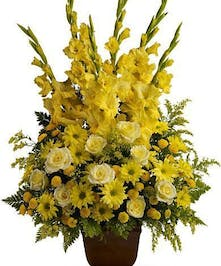 Sympathy basket of bold yellow blossoms.