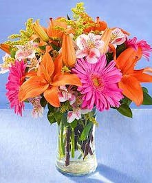 A bright bouquet of lilies and gerbera daisies.