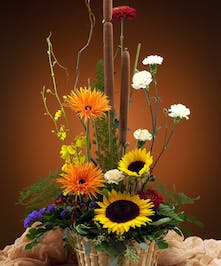 Sunflowers, gerberas and more in a lovely basket.