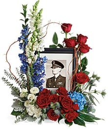 Photo tribute flowers in patriotic red, white and blue flowers.