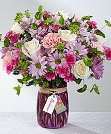 Pink, purple and lavender flowers in a vase.