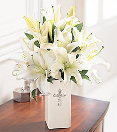 White lilies in a ceramic vase.