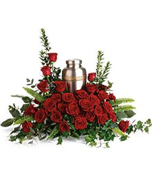 Urn arrangement of roses and greenery.