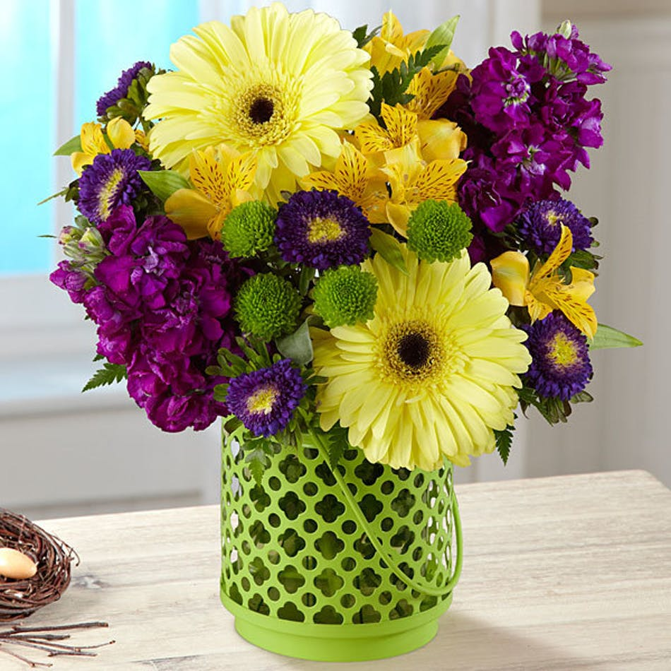 Community garden bouquet bices ft worth flower delivery yellow purple and green flowers in a green lantern style vase izmirmasajfo