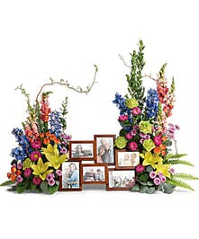 Floral photo tribute of colorful and bright roses, lilies and delphinium.