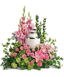 Urn arrangement of pink hydrangea, roses and lilies.