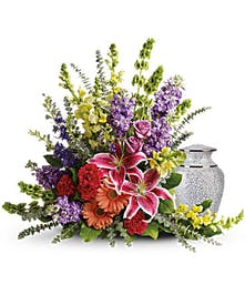 Colorful sympathy arrangement of lilies, roses, snapdragons and more.