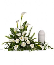 Urn arrangement of all-white calla lilies, roses and more.