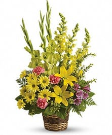 Yellow lilies, gladioli, snapdragons, pink carnations and more in a floor basket presentation.