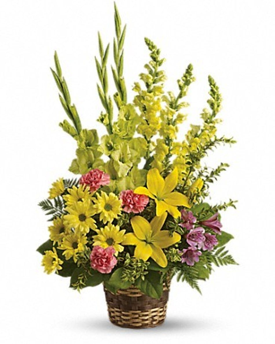 Vivid reflections funeral flowers fort worth dallas yellow lilies gladioli snapdragons pink carnations and more in a floor basket presentation izmirmasajfo