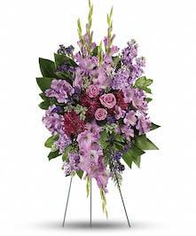 Sympathy spray of lavender roses, alstroemeria, gladioli, stock and more.