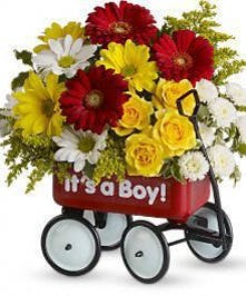 Red wagon filled with flowers that says