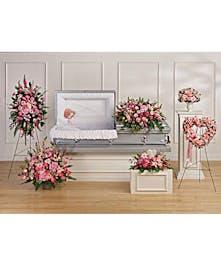 A set of six lavender sympathy flower arrangements.