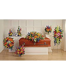 A set of six colorful sympathy flower arrangements.