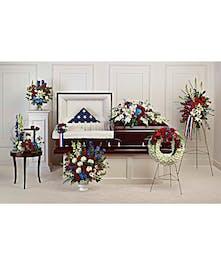 A set of seven patriotic sympathy flower arrangements.