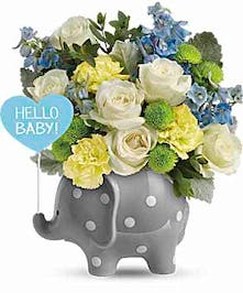 Ceramic elephant with white and blue flowers for a baby boy.