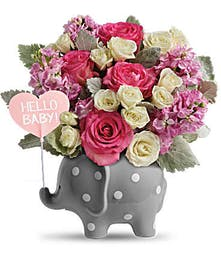 Ceramic elephant with pink flowers for a baby girl.
