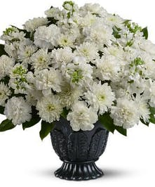 All-white flowers in a decorative urn.