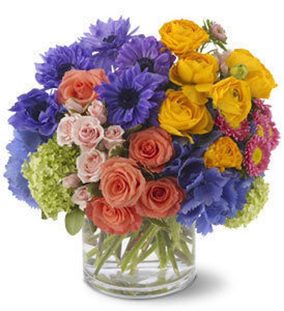 A spring sonnet fort worth spring flower delivery yellow purple pink and green flowers in a glass cube vase izmirmasajfo